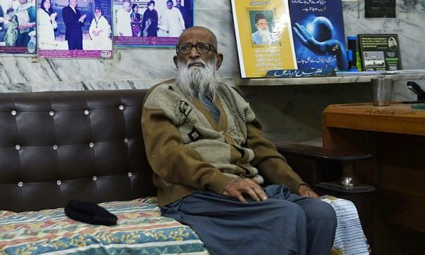Abdul Sattar Edhi sits in his office in Karachi.— AFP/File