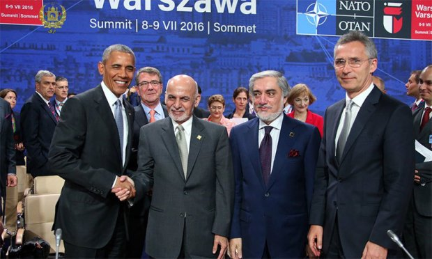 US President Obama shakes hand with Ashraf Ghani during the Nato summit at Warsaw. ─Afghan President's Twitter profile