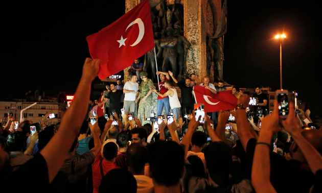 Supporters of Turkey's President Recep Tayyip Erdogan, gather, waving Turkish flags, in Istanbul's Taksim square, early Saturday, July 16. — AP