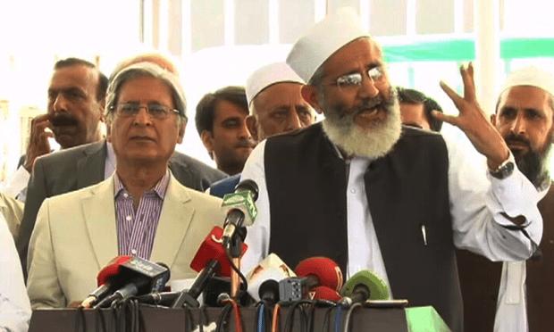 JI's Sirajul Haq speaks outside Parliament House. ─ DawnNews
