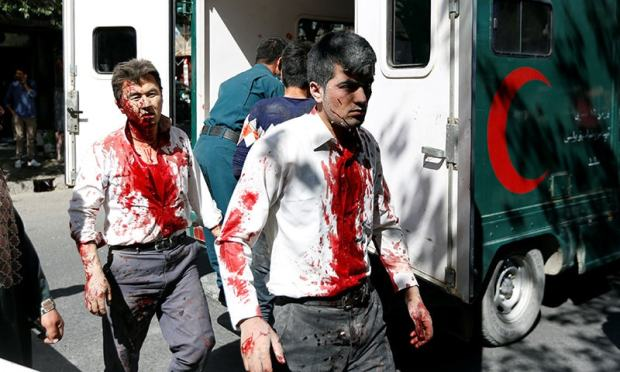 Injured Afghan men arrive at a hospital after the blast in Kabul.— Reuters