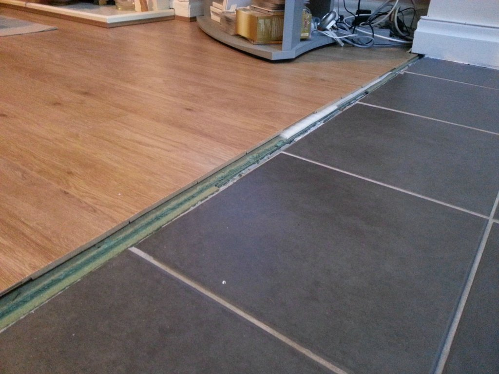 how can i transition between these floors laminate flooring kitchen enter image description here