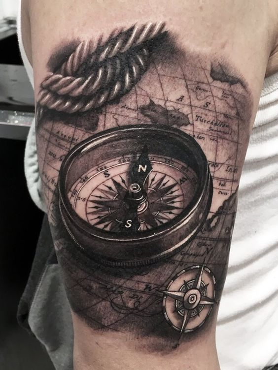 23 Great Compass Tattoo Ideas For Men   Styleoholic artistically rich 3D compass  rope and world map tattoo