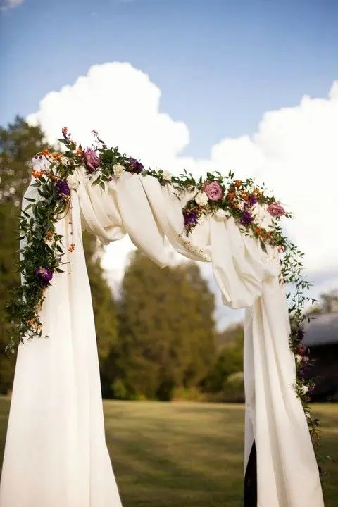 moody floral arch with white fabric