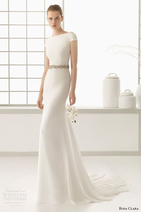 modern wedding dress with a bateau neckline, embellished shoulders and belt