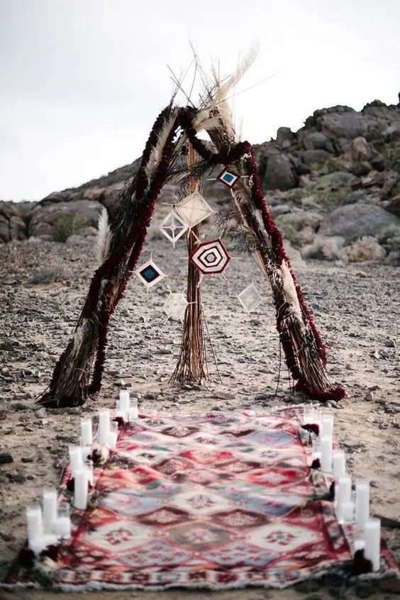 teepee wedding altar with pampas grass, bold dream catchers and flower garlands
