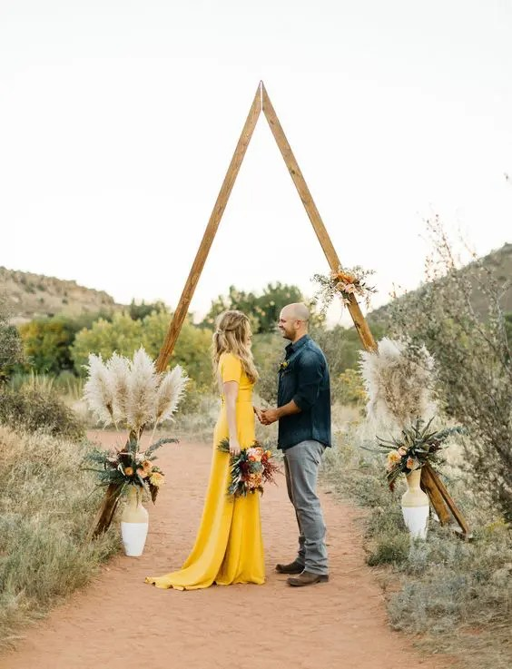 triangle altar with flowers and pampas grass