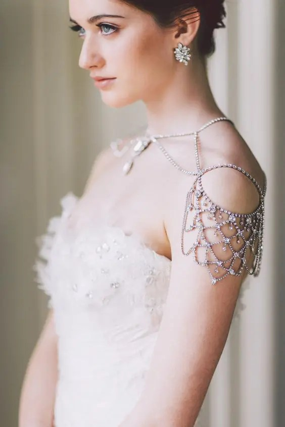 chic rhinestone shoulder jewelry and matching earrings for a sparkling bridal look