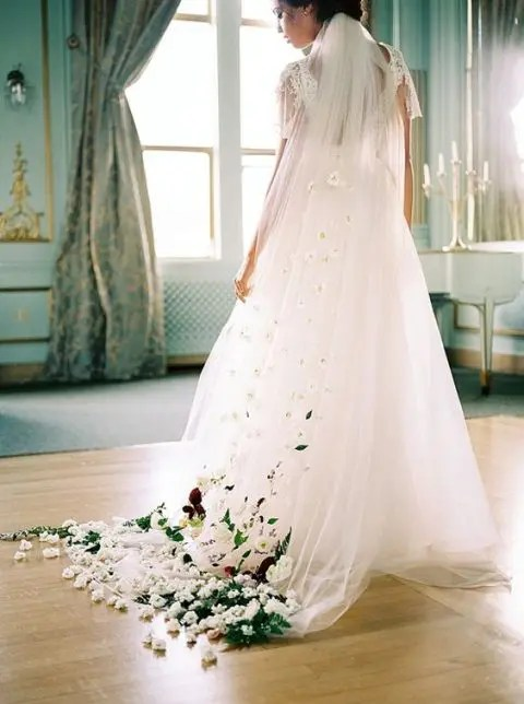 a colorful faux floral wedding veil by Sarah Seven is ideal for a garden bride