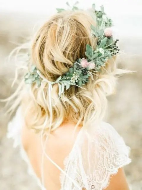a textural greenery crown with pink wildflowers and berries for a summer boho bride