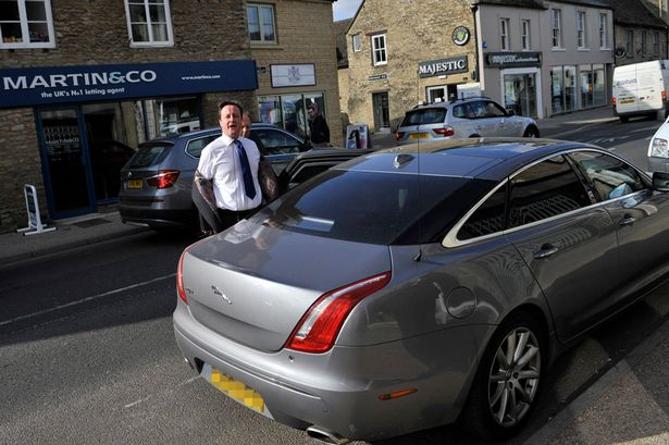 The PM returns to his car after parking regulations were broken