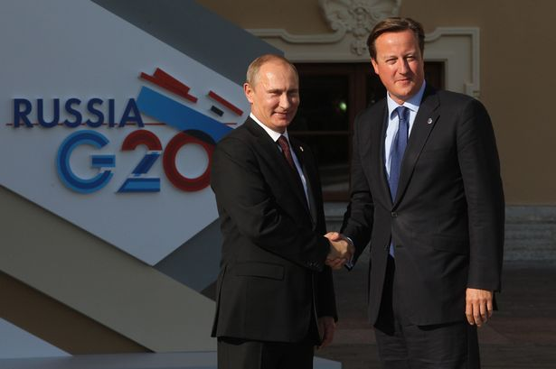 Frosty: Vladimir Putin greets David Cameron