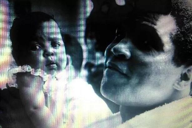 Kiiursten Mensah Ali being held by her dad, boxer Muhammad Ali
