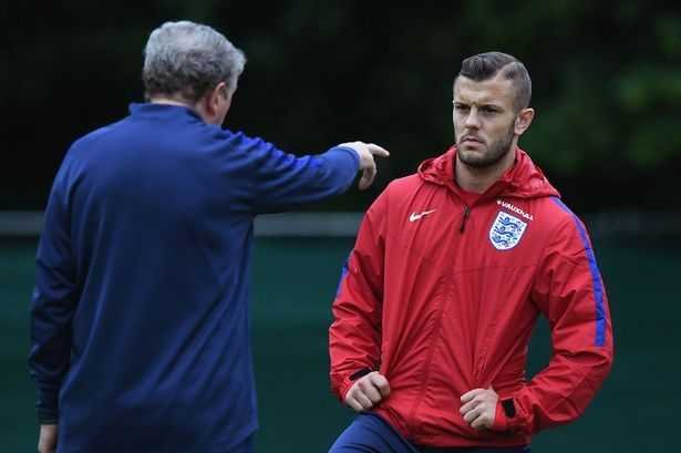 Roy Hodgson speaks to Jack Wilshere