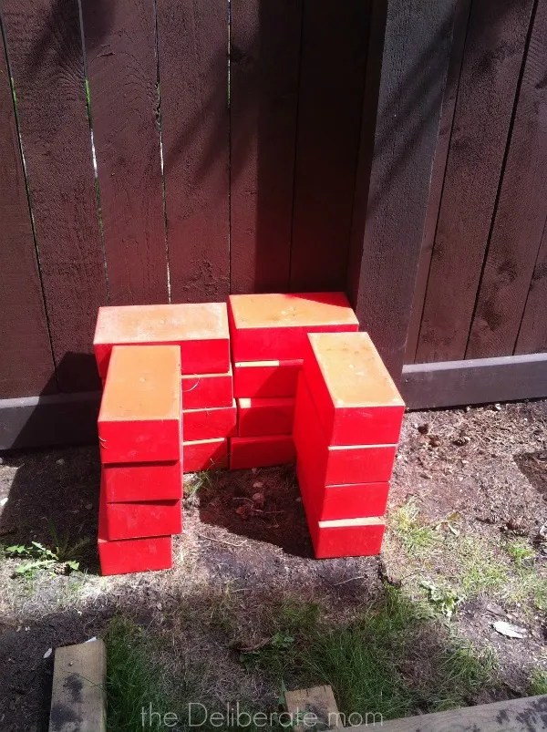 Playspaces for small backyards - building blocks. http://thedeliberatemom.com