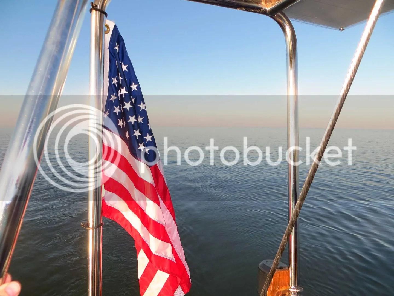 Flag near the calm water