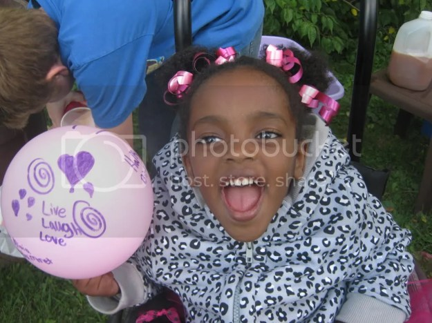 Mihret in her pink wheelchair