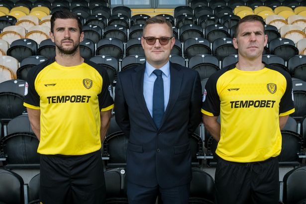 john mousinho left and jake buxton right in the new burton albion kit with tempobet s robin hutchinson image richard holmes fc
