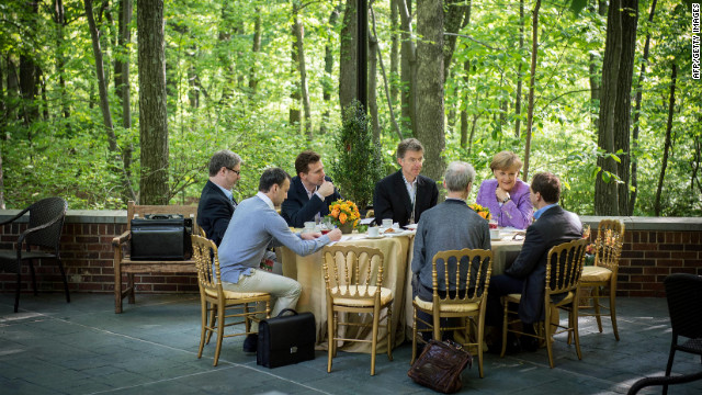 Merkel, second from right, talks with Medvedev, right, during a bilateral meeting on the sidelines of the G8 Summit.
