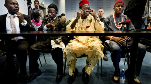 Four Nigerian farmers sit in the law courts in The Hague on October 11, 2012.
