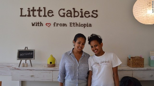 Amelsa Yazew, (L) founder of baby boutique Little Gabies poses with Tensae who works in the shop.