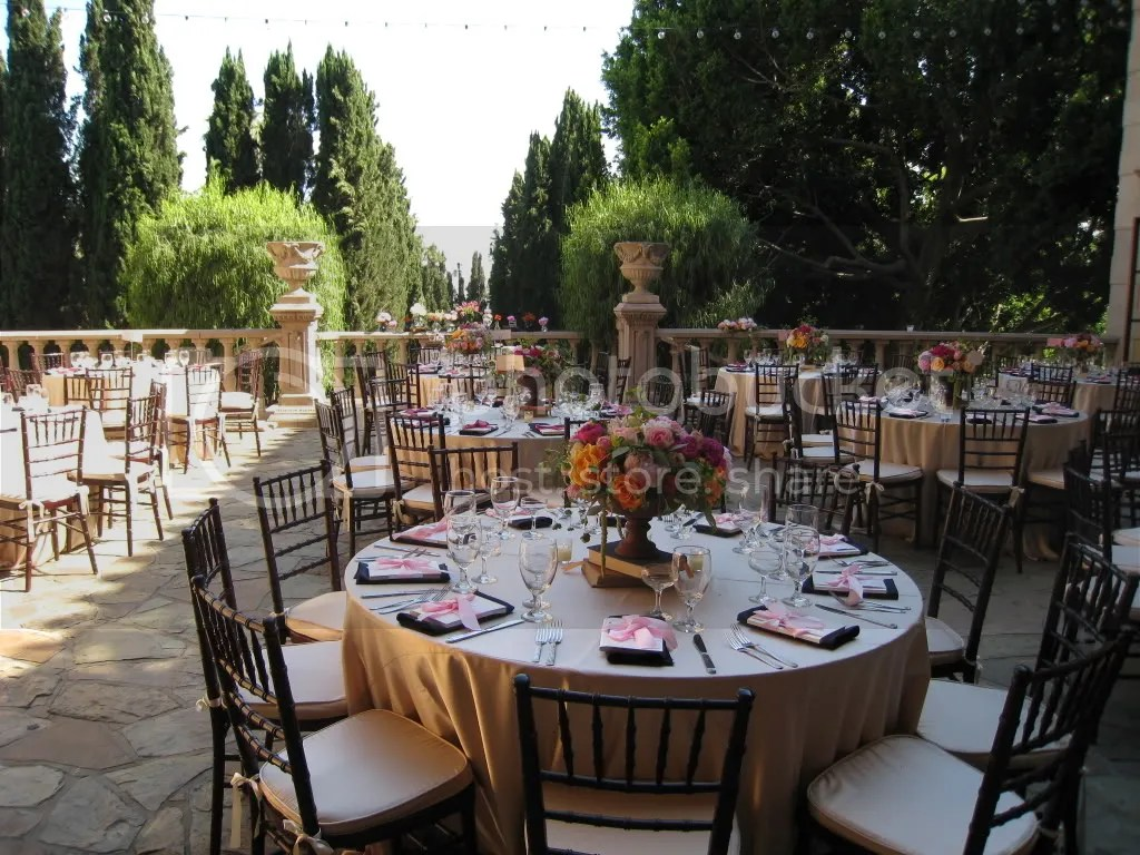 18 wedding linens the shade completely enveloped the gorgeous patio as guests arrived a much needed relief from the heat tables were covered in champagne satin linens