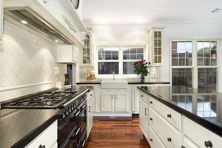clic galley kitchen design using floorboards kitchen