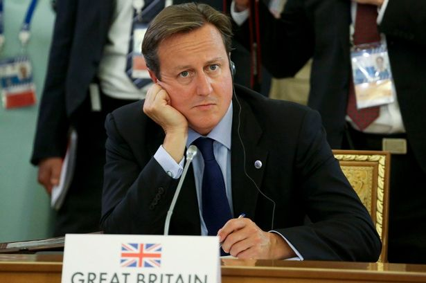Britain's Prime Minister David Cameron listens to statements at G20