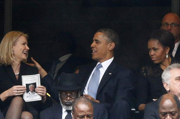 Unhappy: Michelle Obama looked less than impressed as her husband chatted to Denmark's PM Helle Thorning-Schmidt