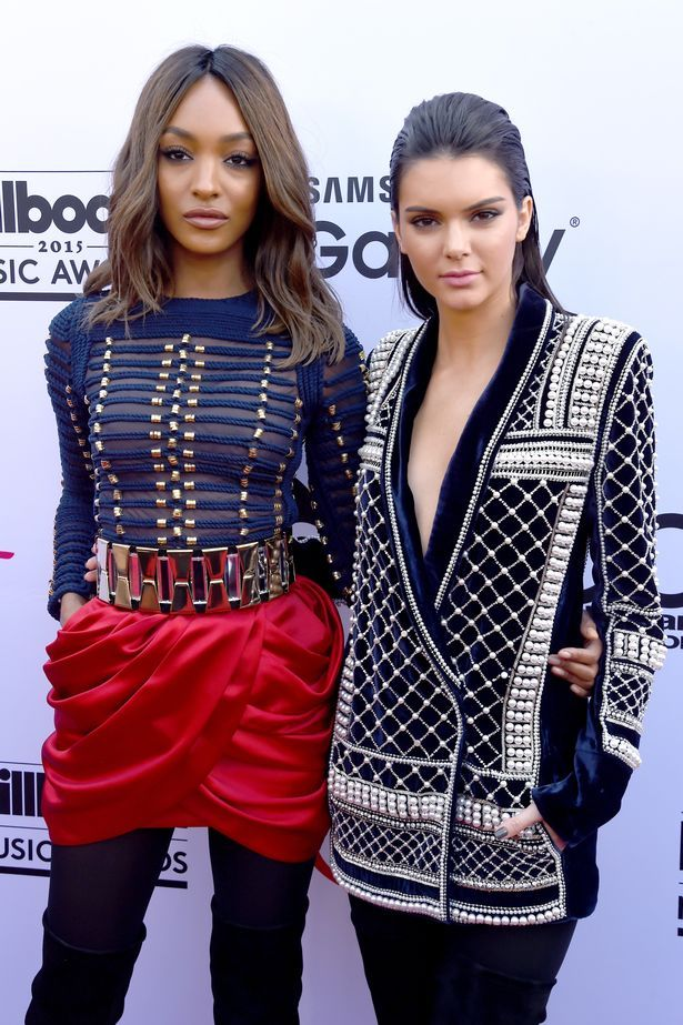 Jordan Dunn (L) and Kendall Jenner, both wearing Balmain x H&M, attend the 2015 Billboard Music Awards