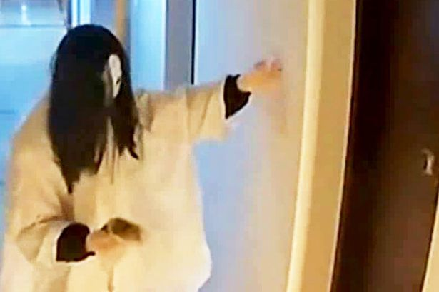 The man dressed as a ghost smearing faeces on Yang's door