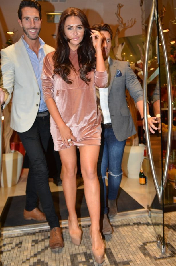 MTV Ex On The Beach star Charlotte Dawson looks to be having a fun night out in Manchester before returning to her hotel and emerging with slippers on and a mystery man.