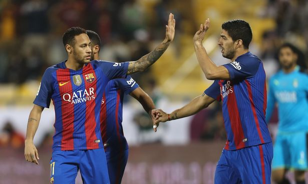 Luis Suarez (R) and Neymar celebrate after a goal