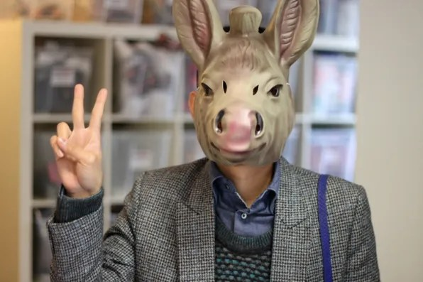 Bryanboy wearing a donkey mask