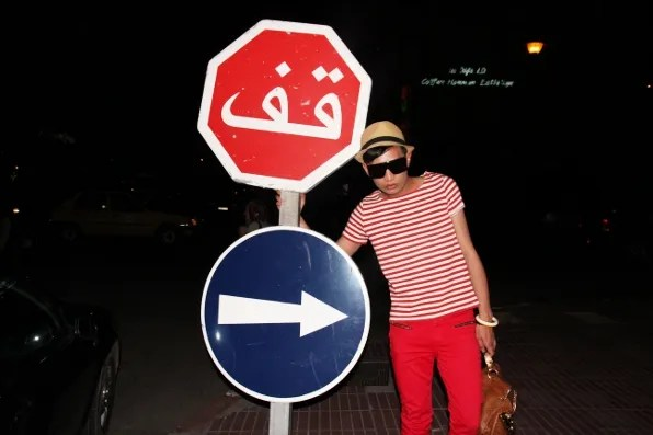 Bryanboy posing with a road sign at Marrakech, Morocco