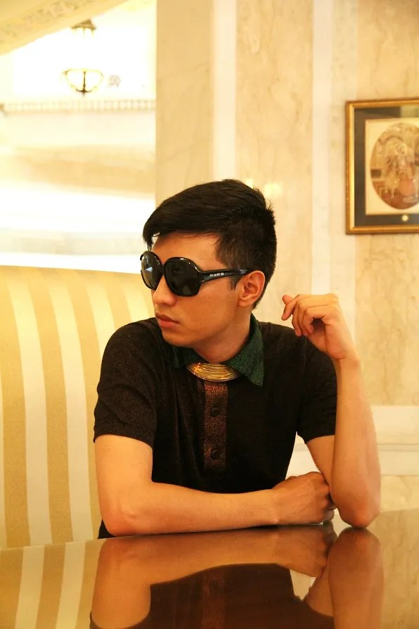 Bryanboy wearing a Prada lurex polo shirt at Orient Taj hotel Agra
