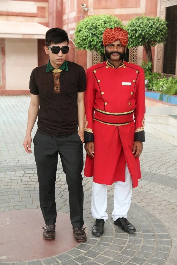 Bryanboy and bellhop at Orient Taj hotel, Agra