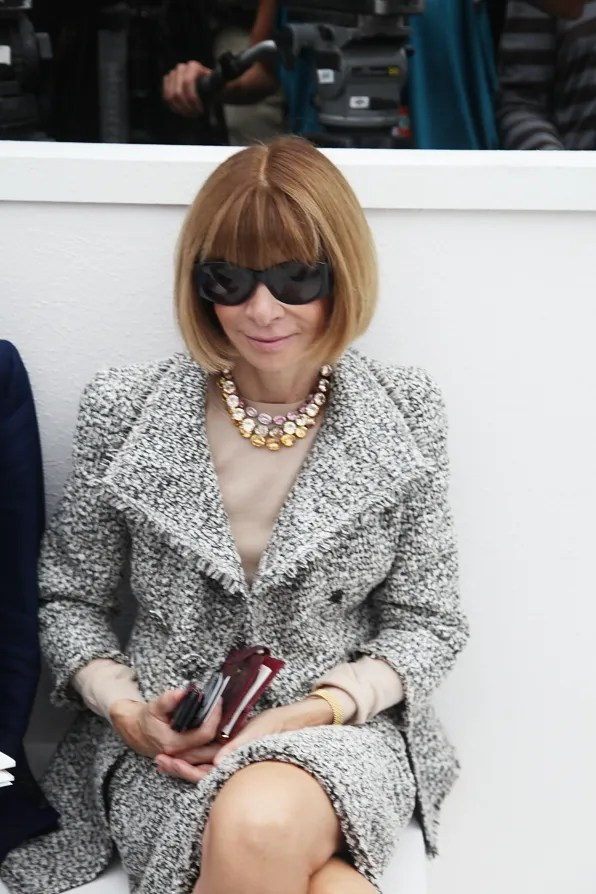 Anna Wintour smiling at Bryanboy at Chanel spring/summer 2012 fashion show.