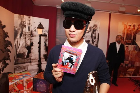 Bryanboy holding a memento from Hermes pop-up studio
