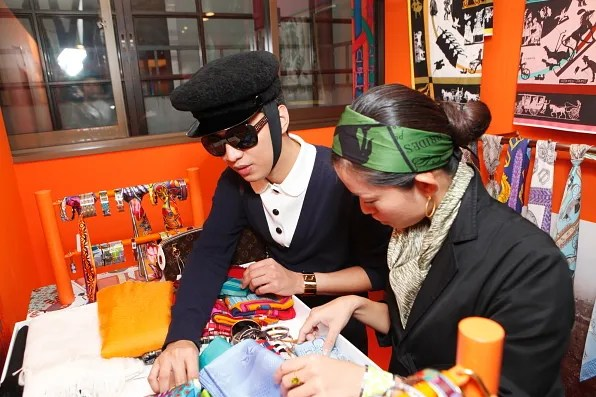 Bryanboy choosing Hermes silk scarves