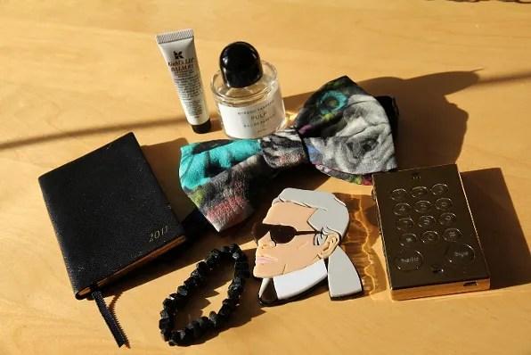 Lanvin bow tie, Smythson diary, black tourmaline bracelet, Byredo Pulp, Kiehl's lip balm, John's phone