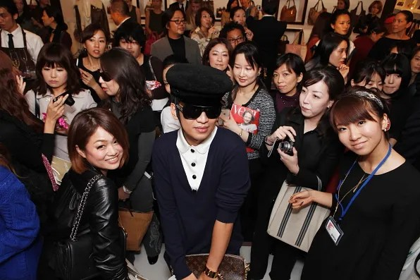 Bryanboy photographed with his fans at the Michael Store Omotesando store