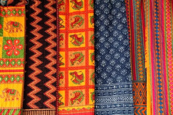 A selection of embroiered bed spreads at Dilli Haat market New Delhi