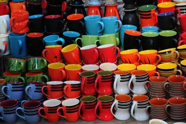Colourful mugs at Dilli Haat market New Delhi