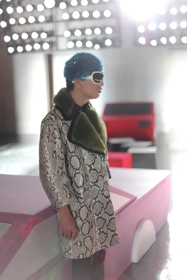 Bryanboy wearing a python skin coat from Prada fall winter 2011
