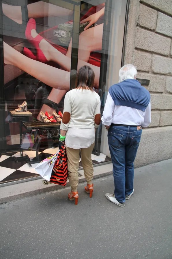 Another woman wearing the same Prada bag and same Prada shoes at Via Montenapoleone, Milan