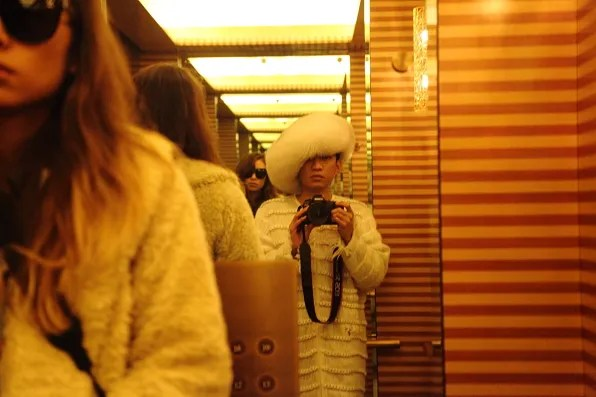 Rumi and Bryanboy inside the Peninsula Hotel Tokyo elevator