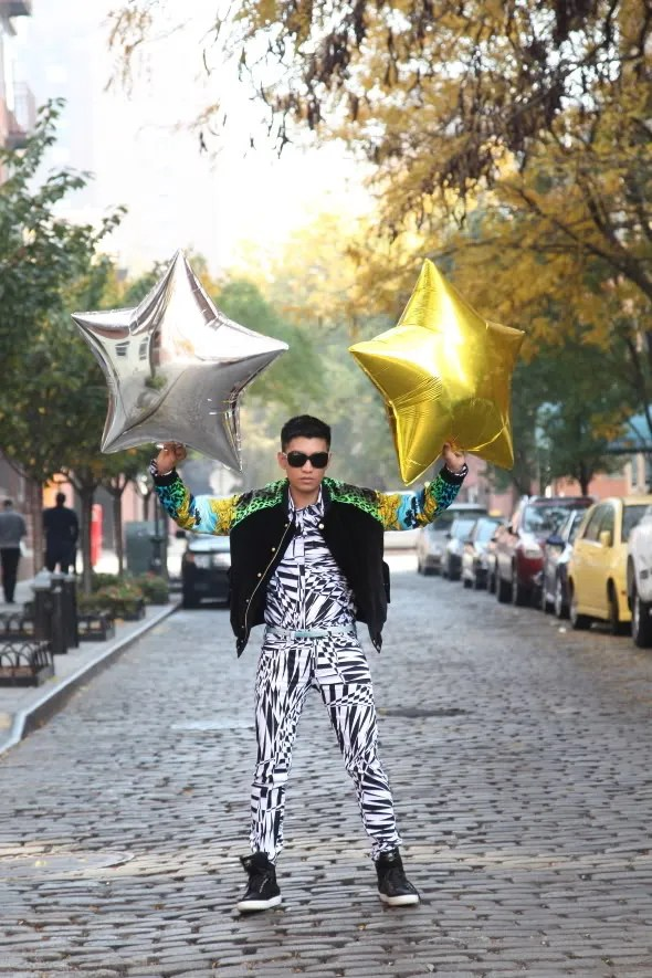 Bryanboy holding star balloons from the 2011 Victoria's Secret Fashion Show