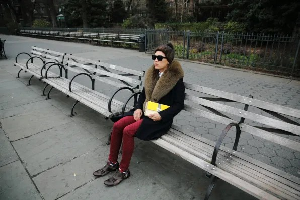 Bryanboy sitting on a bench in Brooklyn Heights