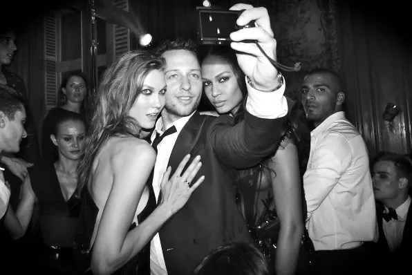Karlie Kloss, Derek Blasberg and Joan Smalls at the Carine Roitfeld ball for MAC Cosmetics